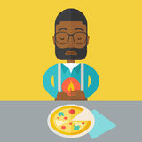 Man with heartburn. A sick african-american man with heartburn due to pizza holding hands on his stomach vector flat design illustration. Square layout Stock Image