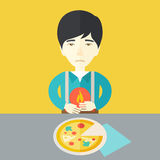 Man with heartburn. A sick asian man with heartburn due to pizza holding hands on his stomach vector flat design illustration. Square layout Royalty Free Stock Photography
