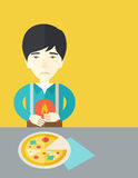 Man with heartburn. A sick asian man with heartburn due to pizza holding hands on his stomach vector flat design illustration. Vertical poster layout with a text Royalty Free Stock Photo