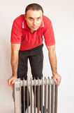 Man and heater Stock Photo
