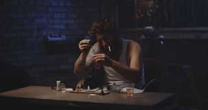 Man heating drug in a spoon. Medium shot of a drug addict heating drug in a spoon over flame stock video