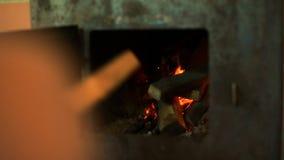 Man heating stove. stock footage