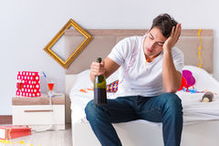 The man after heavy christmas partying at home Stock Images