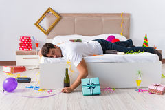The man after heavy christmas partying at home Stock Image