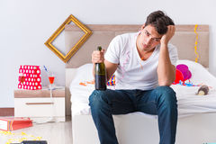 The man after heavy christmas partying at home Royalty Free Stock Images