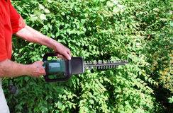 Man with hedge trimmer Royalty Free Stock Photos