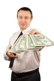 Man held out a bundle of money Royalty Free Stock Image