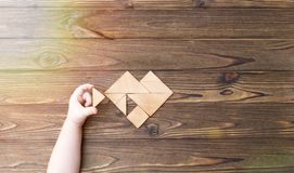 Man held piece of tangram puzzle to fulfill the heart shape Royalty Free Stock Photo