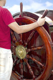 Man at the helm of ship Royalty Free Stock Photography