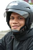 Man With Helmet. Photograph of man with helmet smiling stock image