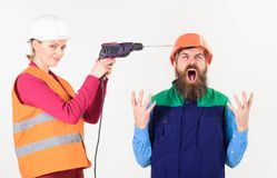 Man in helmet with angry shouting face fed up. Of his wife drilling him. Husband annoyed by wife. Builder makes hole in male head. Marriage issues concept royalty free stock images