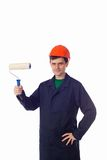 Man in a helmet and blue robe holding painting stock photo