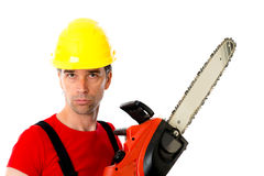 Man with helmet and chain saw Royalty Free Stock Photography