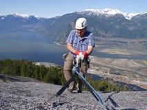 Man in Helmet Climbing Mountains. Royalty Free Stock Image