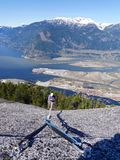 Man in Helmet Climbing Mountains. Stawamus Chief Provincial Park, Squamish, British Columbia, Canada Stock Images