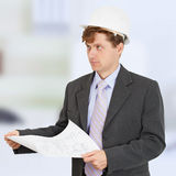 Man in helmet with drawing in hands Royalty Free Stock Photo