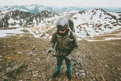 Man with helmet and ice axe climbing in mountains. Travel Lifestyle survival concept adventure outdoor active vacations extreme sport gear wild nature Royalty Free Stock Photos
