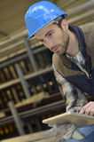 Man with helmet in manufacture using digital tablet Royalty Free Stock Images