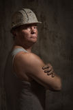 Man in a helmet miner Stock Image