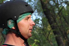 Man with helmet in the park Stock Photos