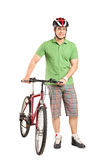 Man with a helmet pushing a bike Stock Photo
