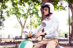 Man in helmet riding on scooter Royalty Free Stock Image