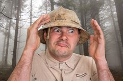 Man with helmet in scary forest in fog stock images
