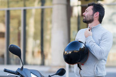 Man with helmet on scooter Stock Photos