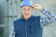 Man in helmet showing hands construction. A man in a helmet showing hands construction stock photography