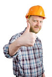 Man in a helmet shows that everything is OK Stock Photos