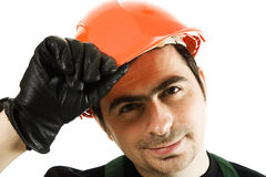Man in a helmet shows a gesture of welcome Stock Images