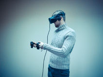 Man in a helmet virtual reality plays a game Royalty Free Stock Images