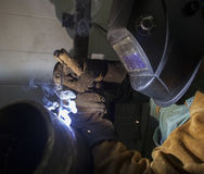 Man in helmet welding Royalty Free Stock Images