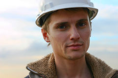 Man in helmet young builder Stock Photo
