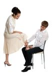 Man help to girl. With shoe Stock Images