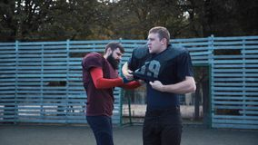 Man helping his mate to put on football jersey Royalty Free Stock Photo