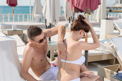 Man Helping his Woman Putting Lotion on her Back Royalty Free Stock Images
