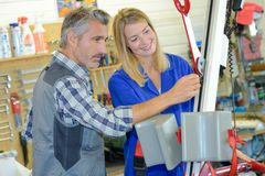 Man helping lady with hoist. Man royalty free stock photography