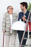 Man helping older woman Stock Photos