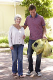 Man Helping Senior Woman With Shopping Stock Photography