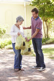 Man Helping Senior Woman With Shopping Royalty Free Stock Photos