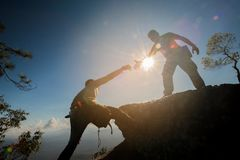 Free Man Helping To Climb The Rock Royalty Free Stock Photography - 104181627