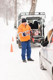 Man helping woman with broken car snow. Man helping women with broken car snow assistance winter mechanic Stock Photos