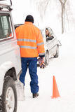 Man helping woman car breakdown assistance snow Royalty Free Stock Photography