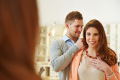 Man helping woman with fitting at Stock Image