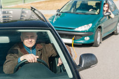 Man helping woman by pulling her car Stock Images