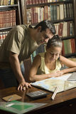 Man Helping Woman Study - Vertical Royalty Free Stock Images