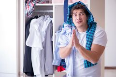 The man helpless with dirty clothing after separating from wife. Man helpless with dirty clothing after separating from wife Royalty Free Stock Photos