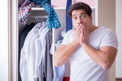 The man helpless with dirty clothing after separating from wife. Man helpless with dirty clothing after separating from wife royalty free stock images