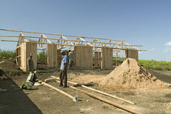Man helps construct new houses for Pepo La Tumaini Jangwani, HIV/AIDS Community Rehabilitation Program, Orphanage & Clinic.  Pepo  Stock Photo